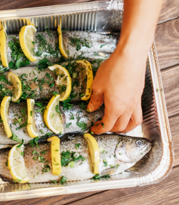 fish in tray with lemon